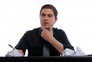 Business man sitting at desk thinking