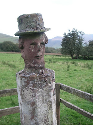 Stone man in a hat
