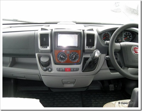 New 7 inch touch screen radio/CD/DVD player with intregal TV/radio digital receiver. SD card reader and aux; MP3/Ipod. It also does the reversing camera.