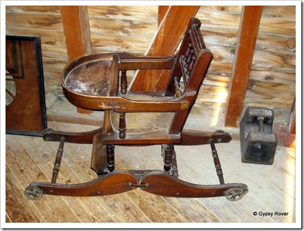 How's this for an old wheel chair/ high chair for a Victorian child.