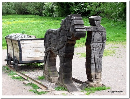 Sculpture to the tramway which ran from Brecon basin back into the mountains, carrying coal out and timber in.