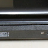 The right side has a USB port, the DVD Writer and the power slot