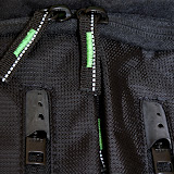 The metal zippers are hidden behind rubber caps so that they don't flap around. The other zippers have reflective thread running through them for better visibility