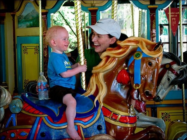 Alex and Mama on carousel at zoo (4)Final