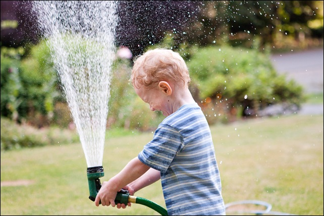 Alex playing with hose-4