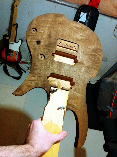 The first shot of dye rubbed into the figured mahogany body. Sort of a &amp;quot;mocha espresso&amp;quot; brown. Left to dry overnight.