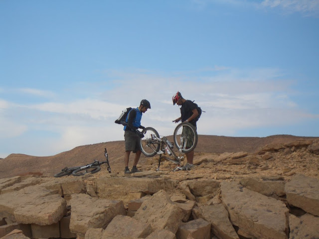 About 15 minutes into the ride, Samer had the first flat of the trip. A tiny puncture probably from one of those thorns that Acasia trees drop.