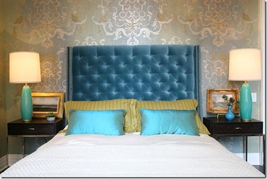 bedroom designed by summer thornton, with tufted turquoise headboard