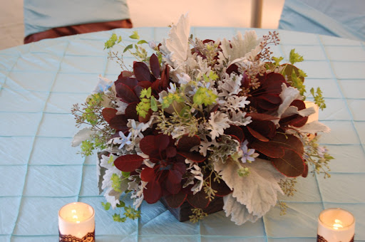 Ice blue and burgundy centerpiece It is always fun to attend networking