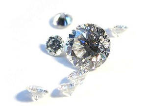 A scattering of round-brilliant cut diamonds shows off the many reflecting facets. - from the wikipedia