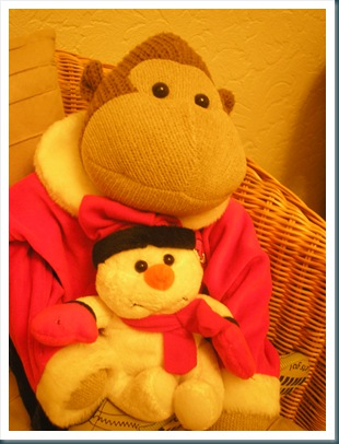 Monkey with snowman