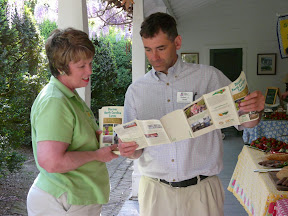 Two people looking at agritourism maps during workshop