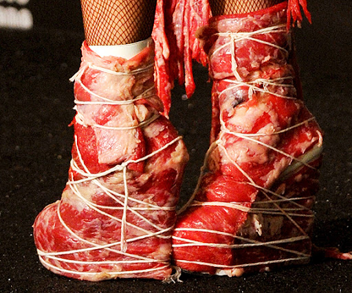 lady gaga meat dress pictures. lady-gaga-meat-dress-outfit-