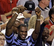 Cleveland Cavaliers' LeBron James holds his New York Yankees hat during the fourth inning of Game 1 of an American League Division Series baseball game between the Yankees and Cleveland Indians Thursday, Oct. 4, 2007, in Cleveland. (AP Photo/Amy Sancetta)