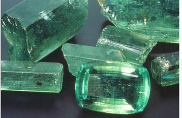 Emeralds cut and faceted and rough .jpg