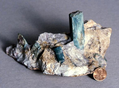 rough crystal green tourmaline in matrix material.jpg