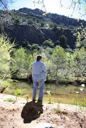 DSC_0033 marchiene reinstra on banks of oak creek playing flute.jpg