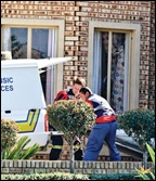 Schonken Isabel farm murder body loaded into forensics van Sept 26 2009 Beeld