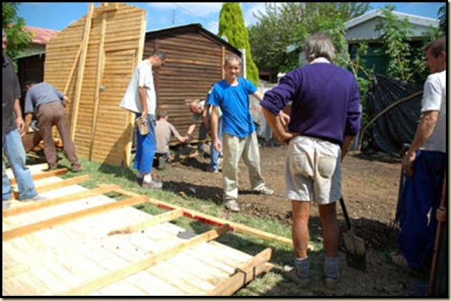 Afrikaner charity workers who built huts for their countrymen were arrested and charged by the ANC-council June 2010