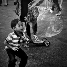 Anticipation by Angie Constable - People Street & Candids ( bubble, black and white, anticipation, boy, street photography,  )