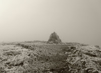 The final cairn on the peak. Photo