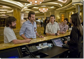 "(L-r) Alan (ZACH GALIFIANAKIS), Phil (BRADLEY COOPER), Stu (ED HELMS) and Doug (JUSTIN BARTHA) check in with reception at Caesars Palace in Warner Bros. Pictures' and Legendary Pictures' comedy ""The Hangover,"" a Warner Bros. Pictures release.