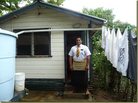 Elder in front of his clean missionary house