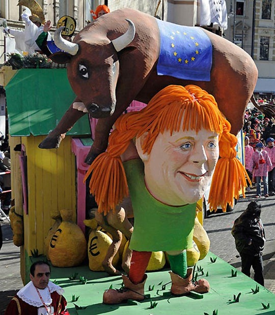 A carnival float shows German chancellor Angela Merkel as Pippi Longstocking with the European bull on her shoulders during the traditional Rosemonday carnival parade in Cologne, Germany, Monday, March 7, 2011.  The Rosemonday parade in Cologne, visited by one million spectators, is one of the highlights of the street carnival season. (AP Photo/Martin Meissner)