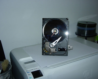 computer recycling - desk clock mounted on an old hard drive