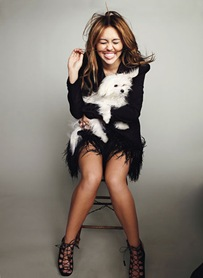 0401-miley-cyrus-dog-in-lap_lg