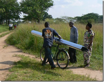 carrying roof sheeting on bike
