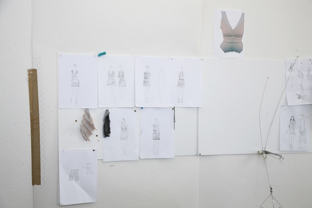 More sketches and material samples  pinned to the wall