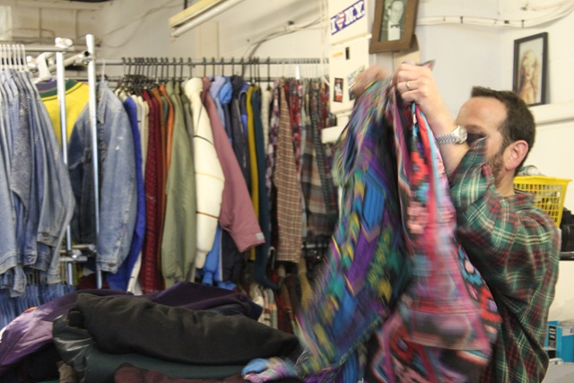 Daniel sorting through some stock and showing off a favourite aztec print Jacket.