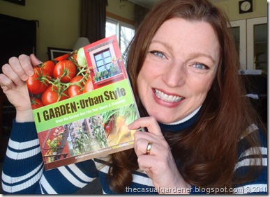 Shawna Coronado holding Michael Nolan's newly arrived urban gardening book