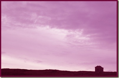 The rejected bothy stood stark on the horizon under a crimson sky