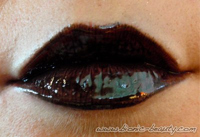 The black lip makeup look using Wet n Wild black lipstick and Sally Hansen lip gloss