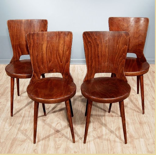 Nice-chairs-from-era-of-Modernism-made-from-quality-dark-wood-for-furnishing-of-the-home