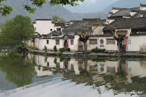 The houses of characteristic Xidi reflected in the moat surrounding the village