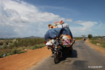 Logistics geta a whole new meaning if you see little moped trucks loaded in Cambodia
