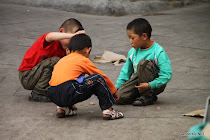 Children playing street games in the streets of Lhasa, Tibet