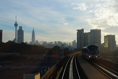Sunrise in Kuala Lumpur. From Hidden Treasures: Late Night Thoughts at The Coffee Bean