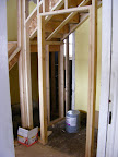 The framing for the front coat closet