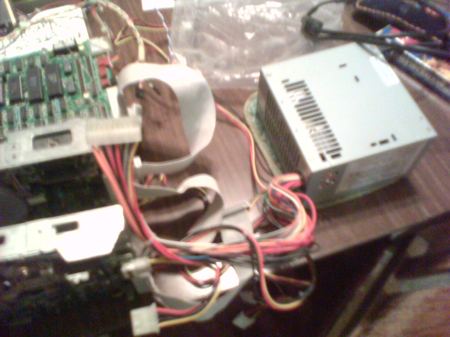 A reused PC power supply, with lots of dangerous loose wires.