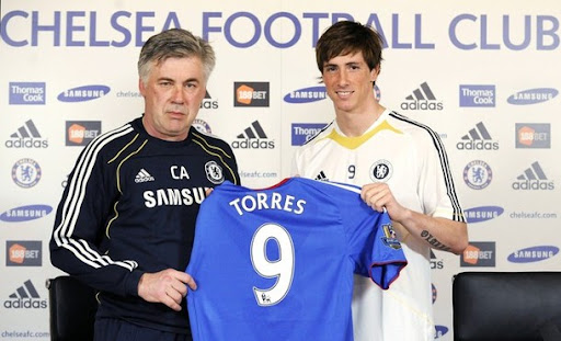 Chelsea manager Carlo Ancelotti and new signing Fernando Torres pose for photographers