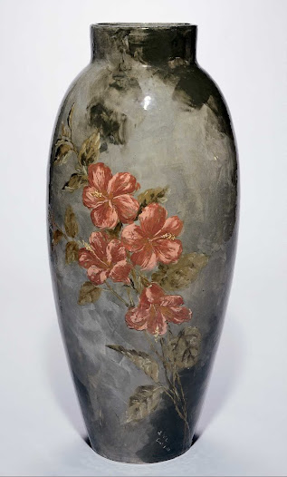 """In August 1879, McLaughlin imagined creating the largest underglaze decorated vase in America. Popular opinion was that """"bigger was better,"""" but it was likely her fierce rivalry with Maria Longworth Nichols Storer that influenced her undertaking. The """"Ali Baba"""" vase is the product of this endeavor."""