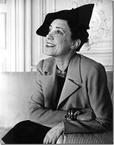 Elsa Schiaparelli wearing a jacket of her new magenta color known as, Shocking.  (Photo by John Phillips//Time Life Pictures/Getty Images)