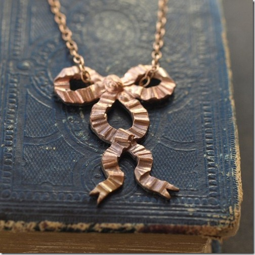 http://www.etsy.com/listing/60910568/ruffled-bow-necklace