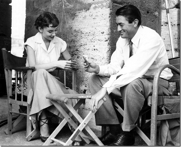Audrey Hepburn and Gregory Peck relax in Rome during a break from shooting the 1953 film