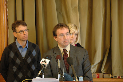 Photo Caption: Tom Chapman, the executive director of the Iowa Catholic Conference, joined legislative advocates of payday loan reform at a news conference at the Iowa Statehouse January 5. The organization, which represents Iowa's Catholics, strongly urges the Legislature to limit the interest rate on payday loans to 36 percent.  Military families already enjoy this protection thanks to Congressional action in 2007. Pictured from left, State Senator Joe Bolkcom of Iowa City, Chapman, and State Representative Janet Petersen of Des Moines. (Photo Courtesy of Iowa Senate