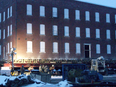 Crews at the old Mills Seed Building set up lights so they can work after dark (2/22/10) KCII NEWS